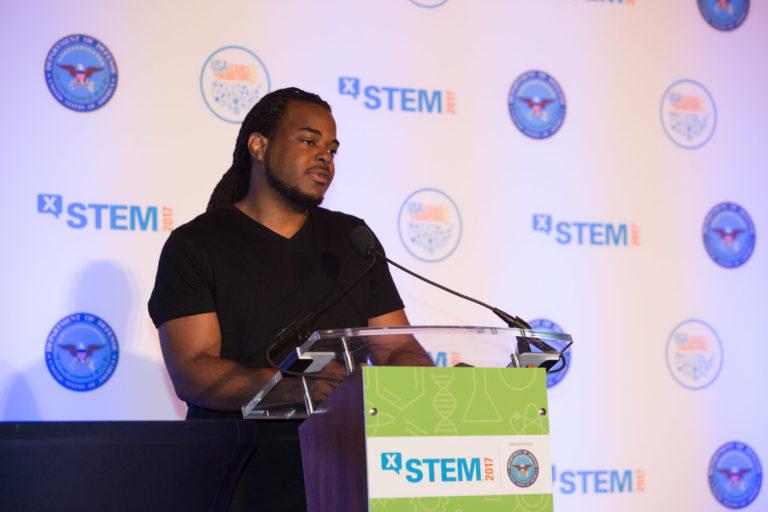 X-STEM Sponsor Logo on screen and podium